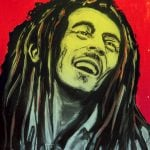 31980733 - sete, france  - september 21, 2014: graffiti portrait of bob marley, a famous jamaican reggae singer-songwriter and guitarist on the wall of sete, south of france.